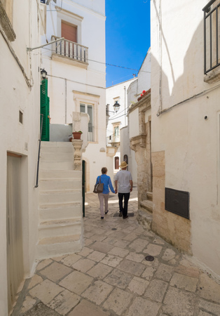 Locorotondo, Italy - 14 May 2018 - The gorgeous white town in Puglia region, chosen among the top 10 most beautiful villages in Southern Italy. Here a view of historic center.