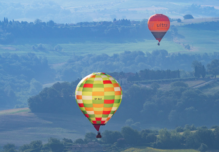 """Todi, Italy - 22 July 2018 - The suggestive medieval town of Umbria region, in a summer sunday morning, during the hot air balloons contest """"Sagrantino Cup 2018"""""""