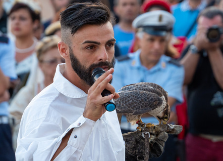 Pisticci, Italy - 29 July 2018 - The medieval festival Enotria Felix in the historic center of the white city in province of Matera, Basilicata region. Here the show of falconry, with eagle, owl and hawks.