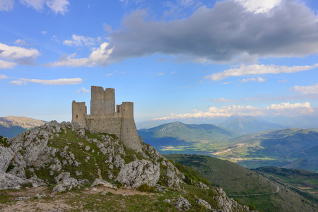 Rocca Calascio (Italy) - The ruins and landscape of an old medieval village with castle and church, over 1400 meters above sea level on the Apennine mountains in the heart of Abruzzo region.