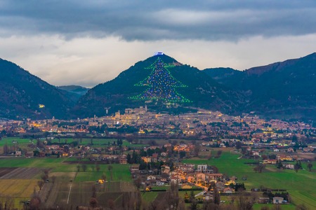 Gubbio (Italy) - One of the most beautiful medieval towns in Europe, in the heart of the Umbria Region, central Italy. Here the biggest Christmas tree in the world. Stock Photo