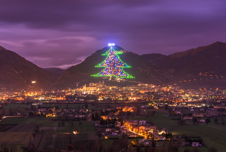 Gubbio (Italy) - One of the most beautiful medieval towns in Europe, in the heart of the Umbria Region, central Italy. Here the biggest Christmas tree in the world. Stock Photo - 111576507