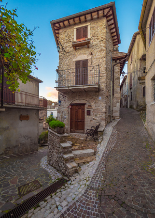 Castel di Tora, Italy - 8 December 2018 - An awesome mountain and medieval little town on the rock in Turano lake, province of Rieti, Lazio region. Here a view of historical center.