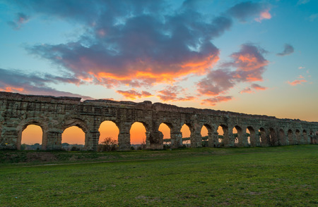 Rome (Italy) - The Parco degli Acquedotti at sunset, an archeological public park in Rome, part of the Appian Way Regional Park, with monumental ruins of roman aqueducts. Reklamní fotografie