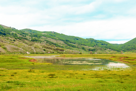Altopiano di Rascino (Rieti, Italy) - The extended plateau of Rascino lake, over a thousand meters high, in the mountains between Lazio and Abruzzo region, province of Rieti, with spring flowering Banco de Imagens
