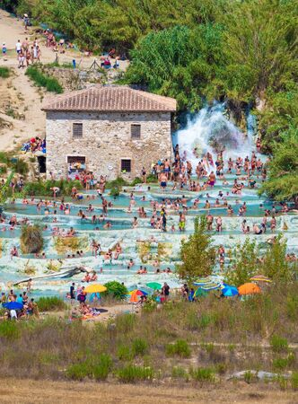 Saturnia, Italy - 15 August 2019 - The thermal waters and little village of Saturnia in the municipal of Manciano, province of Grosseto, Tuscany region 写真素材 - 129933788