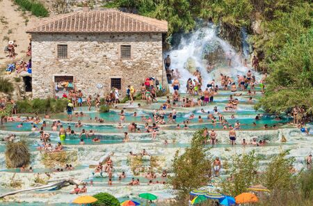 Saturnia, Italy - 15 August 2019 - The thermal waters and little village of Saturnia in the municipal of Manciano, province of Grosseto, Tuscany region Editorial