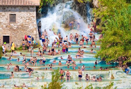 Saturnia, Italy - 15 August 2019 - The thermal waters and little village of Saturnia in the municipal of Manciano, province of Grosseto, Tuscany region 写真素材 - 129933789