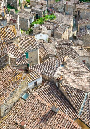 Sorano (Italy) - An ancient medieval hill town hanging from a tuff stone in province of Grosseto, Tuscany region, know as the Little Matera. Фото со стока