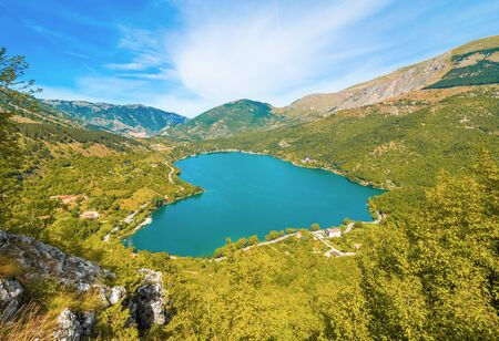 Lake Scanno (LAquila, Italy) - When nature is romantic: the heart - shaped lake on the Apennines mountains, in Abruzzo region, central Italy, during the autumn with foliage