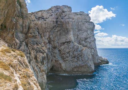 Alghero (Sardegna, Italy) - Capo Caccia coastline and landscape with Neptune's Grotto, cave and cliff, near Alghero city on the island of Sardinia.