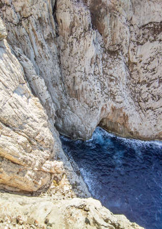 Alghero (Sardegna, Italy) - Capo Caccia coastline and landscape with Neptune's Grotto, cave and cliff, near Alghero city on the island of Sardinia. Stockfoto