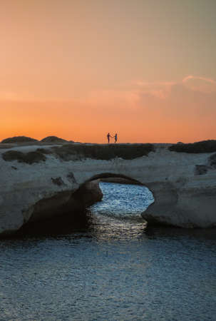 S'Archittu (Italy) - The little arch, in the Sardinian language, is a small coastal touristic town in province of Oristano, Sardinia region and island. Here a view at sunset. Reklamní fotografie