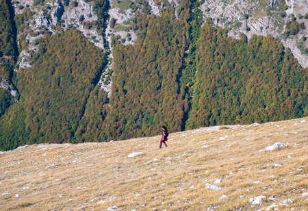 Woman hiker walking on the Mount Velino in Abruzzo region (Italy)