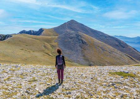 Woman hiker on the Mount Velino in Abruzzo region (Italy)