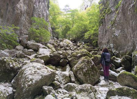 Gole di Celano (Italy) - A woman hiker in the naturalistic wild attraction for trekking, in the Natural Park Sirente-Velino, Abruzzo region. Reklamní fotografie