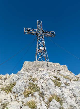 Mount Velino (Abruzzo, Italy) - The iron cross in the landscape summit of Mount Velino, one of the highest peaks of the Apennines mountain, 2487 meters.