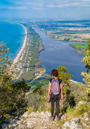Mount Circeo (Latina, Italy) - The famous mountain on the Tirreno sea, in the province of Latina, very popular with hikers for its beautiful landscapes. Here with girl hiker.