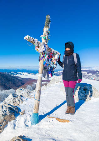 Mount Autore Livata, Italy - 16 January 2021 - The snow capped peaks mountains in the province of Roma, Lazio region, in Simbruini mounts. Here a beautiful white landscape with girl hiker.