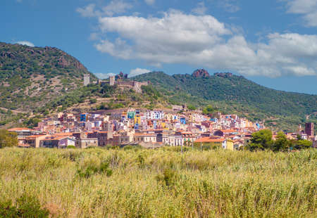 Bosa (Sardinia, Italy) - A view of the touristic and charming colorful old town in the marine coast of Oristano, one of the most beautiful on the island of Sardegna. Reklamní fotografie - 167159067