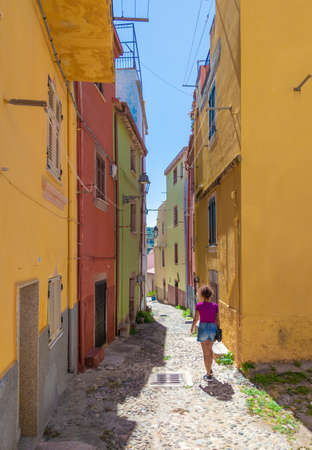 Bosa, Italy - 4 September 2020 - A view of the colorful old town in the marine coast of Oristano, island of Sardegna.