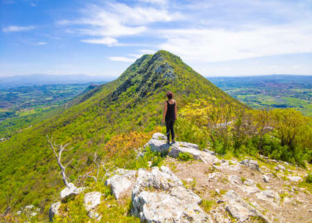 Sant'Oreste (Italy) - Girl hiker and landscape in Mount Soratte with old hermitages, in the natural reserve in province of Rome, during the spring. Reklamní fotografie