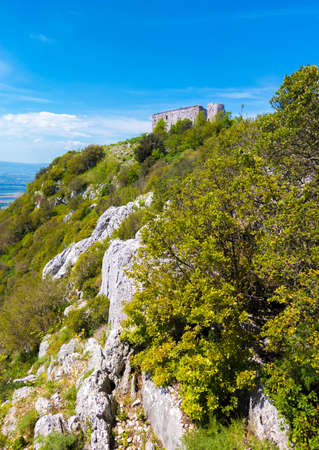 Monte Soratte in Sant'Oreste (Italy) - A view of landscapes with old hermitages in the mountain natural reserve in province of Rome, Sabina area, during the spring. Stock Photo