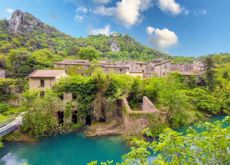 Gole del Nera (Narni, Italy) - The old railway transformed in a cycle path, with the evocative landmarks of the medieval village of Stifone and the crystalline water of Mole; Umbria region.