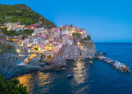 A view of Manarola, one of Five Lands villages in the coastline of Liguria region, part of the Cinque Terre National Park (Italy)