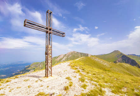 Monte Priora in Montefortino (Italy) - Big Christianity cross on The landscape summit of Mount Priora, in Marche region province of Fermo, at 2332 meters. Archivio Fotografico