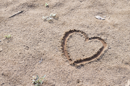 love sign on sand