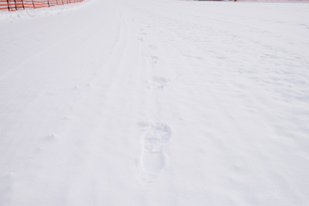 ordeal: foot prints in snow Stock Photo