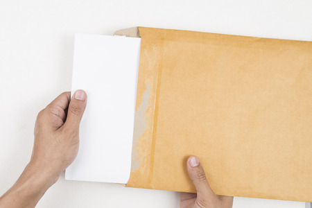open envelope: Hand holding envelope and open envelope isolated on white background. Stock Photo