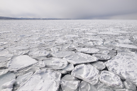 parting the sea: ice sheet in ocean and sky