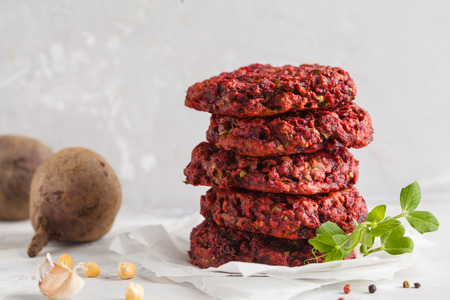 Beetroot vegan burgers with chickpea and herbs. Healthy vegetarian food concept.