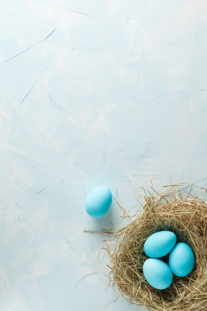 Tender white blue Easter decoration, painted Easter eggs. Copy space, Ester holiday postcard concept. Stock Photo
