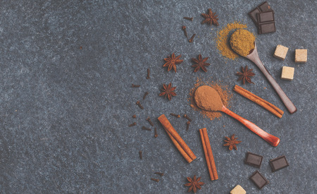 Selection of sugar, chocolate, spices, cocoa. Ingredients for cooking cocoa. Dark background, top view, copy space. Stock Photo