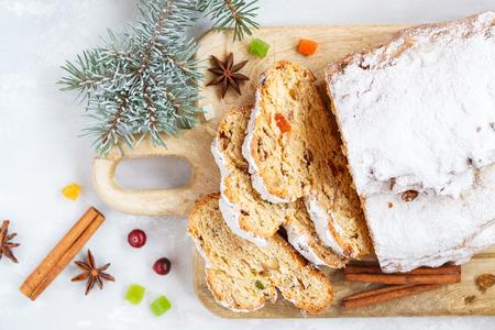Christmas stollen, light background. Traditional German festive baking.