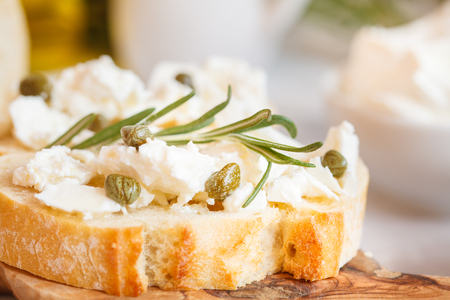 Fresh sandwiches with ciabatta and feta on a wooden board Stock Photo