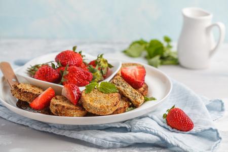 Vegan sweet tofu fritters with strawberries. Healthy vegan food concept.