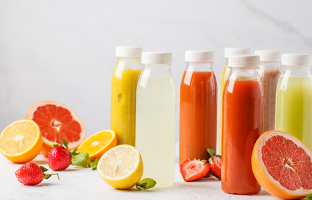 Variety colorful smoothies or juices bottles from berries, fruits and vegetables. Detox program, healthy lifestyle concept.