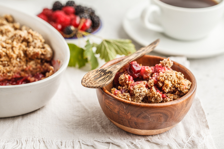 Breakfast with coffee and crumble pie, white background, healthy breakfast concept. Vegan berry dessert.