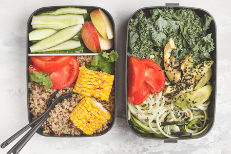 Healthy meal prep containers with quinoa, avocado, corn, zucchini noodles and kale. Takeaway food. White background, top view.