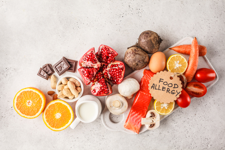 Allergy food concept. Allergies to fish, eggs, citrus fruits, chocolate, mushrooms and nuts. Health and medicine in food. White background, top view, copy space. Stock Photo