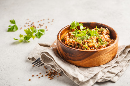 Buckwheat with meat in a wooden bowl on a white background. Russian food, vegan food concept. Stok Fotoğraf