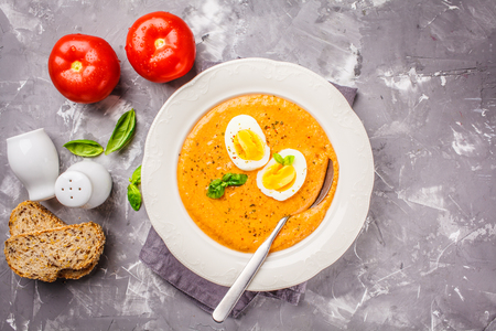 Homemade Spanish salmorejo with egg in a white plate, copy space. Reklamní fotografie