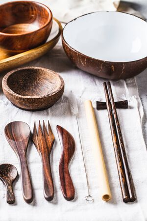 Eco friendly bamboo cutlery and dishes, white background, zero waste concept. Plastic free concept.