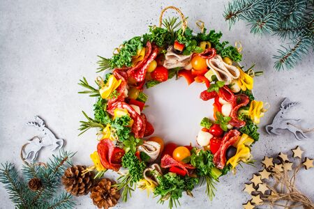 Christmas food background. Christmas wreath of holiday appetizer, white background, top view.
