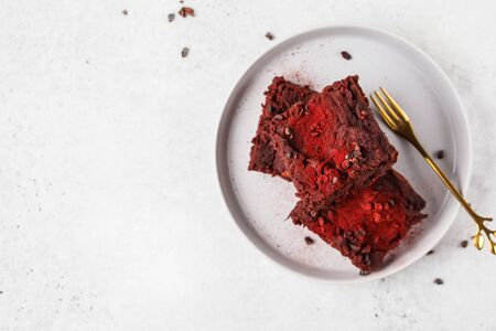 Beetroot vegan brownie on gray plate. Healthy vegan food concept.