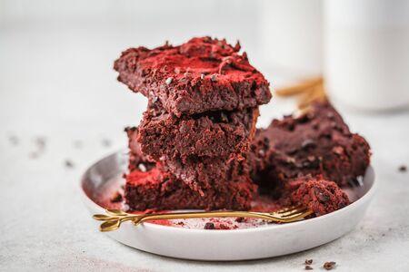 Beetroot vegan brownie on gray plate. Healthy vegan food concept.